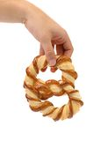 Hand holds freshly fancy pretzel baked. Royalty Free Stock Photo