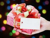 Hand holds a gift Stock Photo