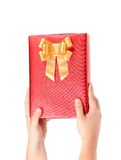 Hand holds gift box. Royalty Free Stock Photo