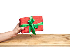 Hand holds a gift on a white background Royalty Free Stock Photography