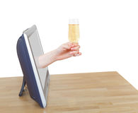 Hand holds glass with sparkling wine leans out TV Stock Image