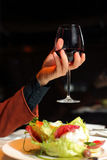 Hand holds a glass of wine Royalty Free Stock Photo