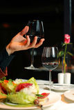 Hand holds a glass of wine Royalty Free Stock Photos