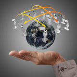 Hand holds globe and social network Royalty Free Stock Image
