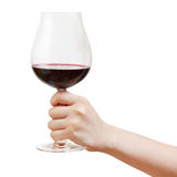 Hand holds goblet glass with red wine Royalty Free Stock Photos