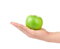 Hand holds green apple. Royalty Free Stock Images