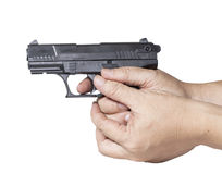 Hand holds gun isolated on white Royalty Free Stock Photo