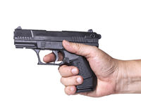 Hand holds gun isolated on white Stock Photography