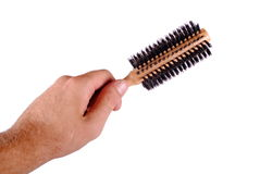 Hand holds a hair brush Royalty Free Stock Photos