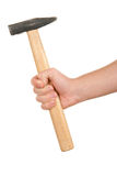 Hand holds hammer Royalty Free Stock Image