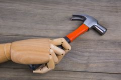 Hand holds a hammer royalty free stock images