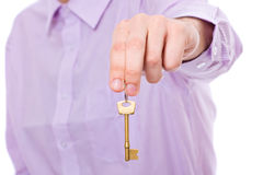 Hand holds house door key Royalty Free Stock Image