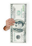 Hand holds huge dollar isolated on white Royalty Free Stock Photography