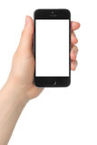 Hand holds iPhone 5s Space Gray on white background. KIEV, UKRAINE - MARCH 7, 2015:Hand holds iPhone 5s Space Gray on white background.iPhone is a line of Royalty Free Stock Images