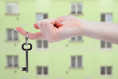 Hand holds a key Stock Photography