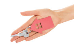 Hand holds key with a keychain the shape of house. Stock Photography
