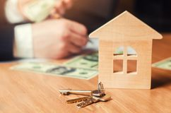 The hand holds the keys to the house. concept of real estate. sale or rental of housing, apartment rental. realtor. signing an apa. Concept of real estate. sale Stock Image