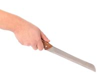 Hand holds knife for bread. Royalty Free Stock Photo