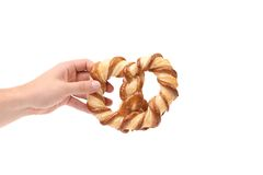 Hand holds knot-shaped biscuits Stock Photography
