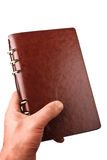 Hand Holds a Leather Notebook Stock Image