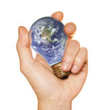 Hand holds a light bulb of the Earth Royalty Free Stock Photography