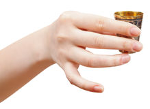 Hand holds little metal glass with spirit Stock Photo