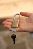 Hand holds lock. Stock Image