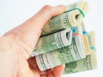 Hand holds a lot of packs with dollars Stock Photography