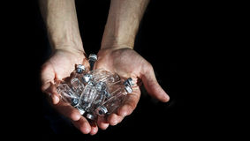 Hand holds  Medicine Glass Ampoules, empty insulin on a black ba. Hand holds  Medicine Glass Ampoules, empty insulin Royalty Free Stock Image