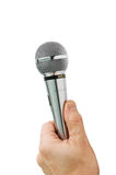 Hand holds the microphone Stock Photography