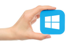 Hand holds Microsoft Windows on white background Stock Image