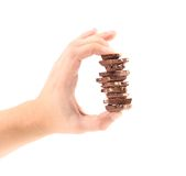 Hand holds milk chocolate with nuts. Stock Photo