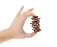 Hand holds milk chocolate with nuts. Royalty Free Stock Photos