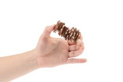 Hand holds milk chocolate with nuts. Stock Photography