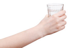 Hand holds mineral water in glass isolated Stock Photography
