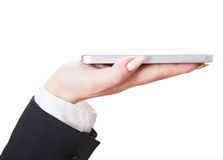 Hand holds mobile phone Stock Image