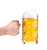 Hand holds mug of beer with foam. Royalty Free Stock Photos