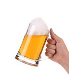 Hand holds mug of beer with foam. royalty free stock photography