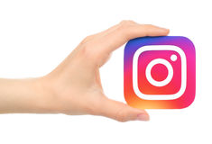 Hand holds new Instagram logo printed on paper Stock Image