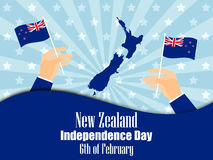 Hand holds a New Zealand flag, independence day. Vector Stock Photos
