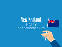 Hand holds a New Zealand flag, independence day. Vector Stock Image