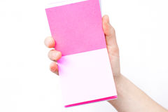 Hand holds notebook open. Blank white paper. Place for an inscription Stock Photography