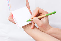 Hand holds notebook open. Blank white paper. Place for an inscription Royalty Free Stock Images