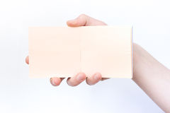 Hand holds notebook open. Blank white paper. Place for an inscription Stock Images