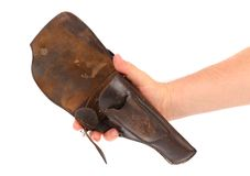 Hand holds old brown holster Stock Image