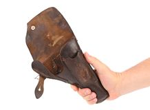 Hand holds old brown holster. Stock Images