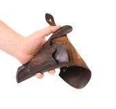 Hand holds old brown holster. Royalty Free Stock Image