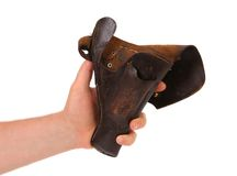 Hand holds old brown holster. Stock Image