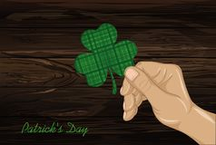 Hand holds ornate clover four-leaf. Celebration concept St. Patr Stock Photography