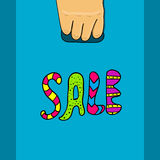 Hand holds a package with text sale Royalty Free Stock Photos